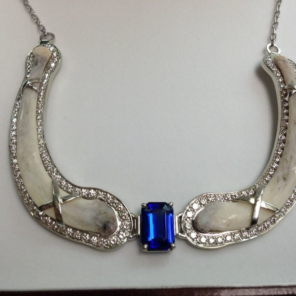 Lion floating throat bones necklace accented with diamonds and Tanzanite set in white gold.